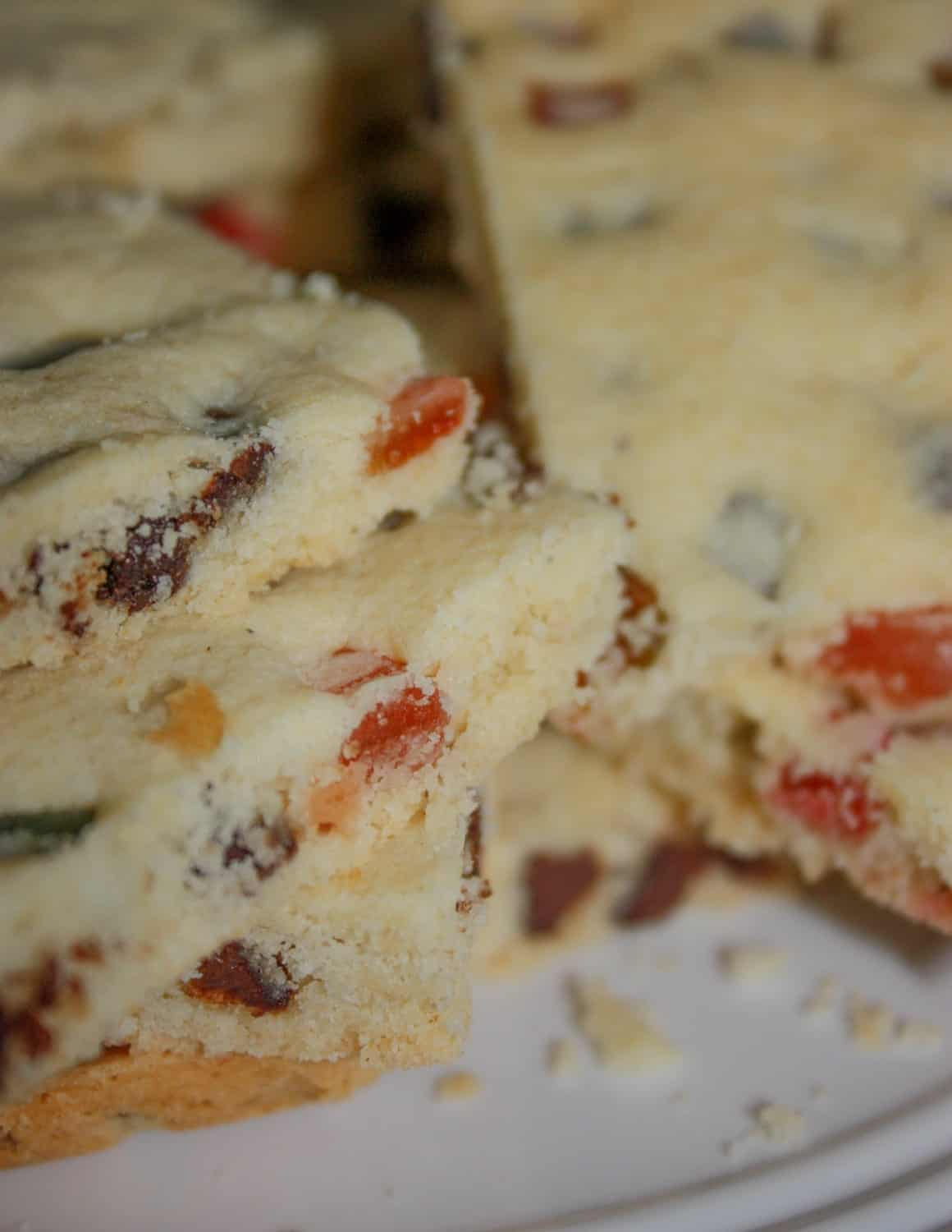 Festive Shortbread Cookie Bars are a colourful addition to any holiday dessert tray. This gluten free version will certainly hit the spot for anyone whether they have a gluten intolerance or can eat a regular diet.