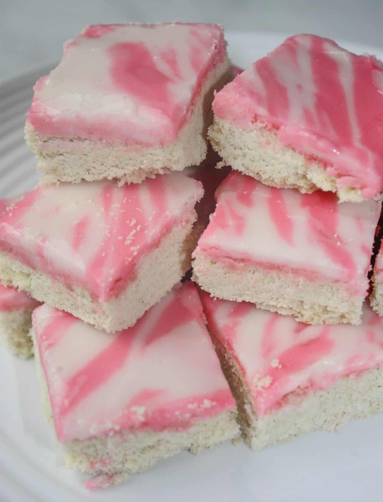 If your life is too busy to make cut out cookies for Valentine's Day this is a great alternative.Iced Sugar Cookie Squares are a sweet and pretty dessert that would be a hit at any Valentine gathering.