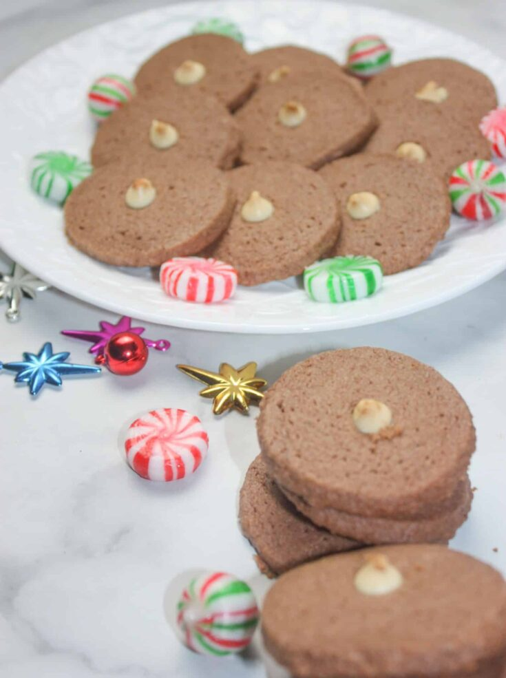 Chocolate Shortbread Cookies are a light, melt in your mouth variation of traditional shortbread. This gluten free holiday recipe is a delicious addition to any dessert tray.